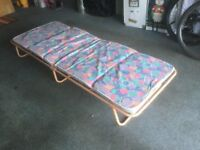 Folding bed with mattress, excellent condition, hardly been used