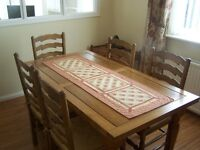 Oak Dining room table with 2 extensions and 6 chairs