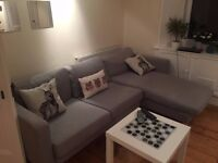 IKEA Karlstad sofa with chaise in mid-dark grey