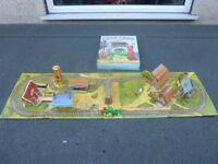 Pop up book into village train track.