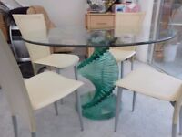 Glass spyrel table and 4 cream chairs