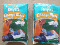 2 packs of pampers changing mats