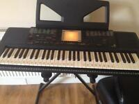 Yamaha piano keyboard with stand
