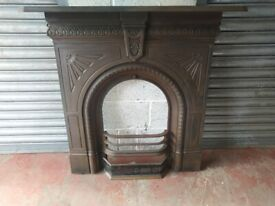 ANTIQUE CAST IRON FIREPLACE WITH GRATES