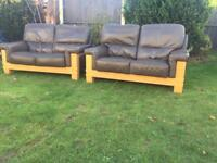 Brown leather sofas 2 seaters with oak frames. Can deliver