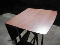 Wooden drop - leaf dining table