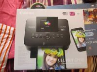 Canon Selphy printer....& paper/ink...BRAND NEW.
