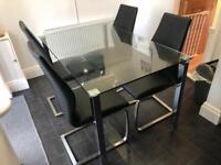 Housing units glass table with 4 leather chairs