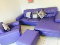 Leather sofa chair and matching footstool