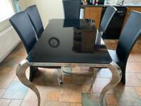 Black an Silver glass top dining table
