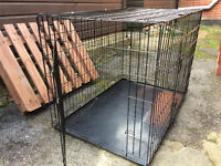 """Large dog cage, 43"""" x 29"""" x 29"""" folds flat with carry handle."""