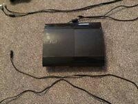 Playstation 3 with 2 controllers and 8 games