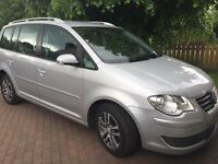 Silver, 7 seater car, practical and economical, 2 owners and low mileage.