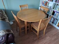 Solid Oak Round Drop Leaf Table and 4 Matching Chairs