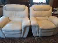 2 cream leather electric reclining chairs.