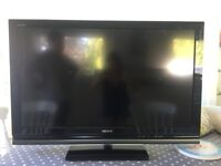 Sony flat screen LCD TV 42inch and large glass Tv stand