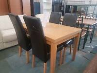 Oak effect table and 4 chairs