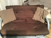Chocolate brown sofa bed fully assembled with two brown cushions. Been used plenty of wear left