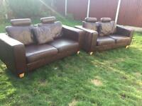 Pair of matching premium luxury modern brown leather sofas. From Selfridges can deliver