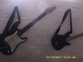 electric guitar . , free amp and patch lead with this.£20 (smaller guitar now sold..)