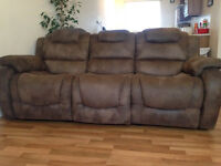 Three piece recliner sofa and two matching armchairs.