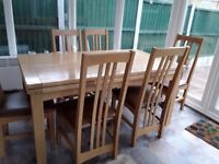 Solid oak 6 seater dining table extendable with 6 chairs