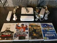 Nintendo Wii gloss white 4x games remote and cables