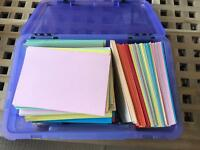 Over 100 folded coloured cards in box
