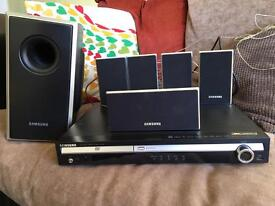 SAMSUNG DVD player and surround sound system.