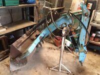 Compact tractor rear hydraulic loader bucket