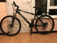 Professional mountain bike, disc breaks, front suspension, 26 inch alloy wheels.