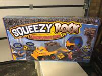 Brand new squeezy rock with mini digger