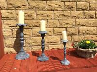Set of 3 large heavy candle holders with candles