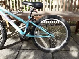 Two children's bikes well loved but outgrown in good condition (with free helmet)