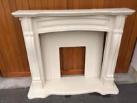 Fireplace surround. Limestone type man made material
