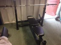 Powertec Olympic weight bench with 7ft bar and leg extension attachment black