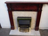 Mahogany effect fire surround and marble