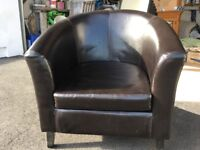 Faux leather tub chair. Loose cushion. Tiny major at back seam but noticable as per photo. £10.