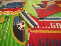 Boys football themed single bedding and curtains.