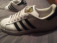 Addidas white and black superstars size 9.5