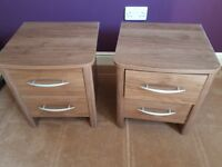 2 Matching bedside tables both with 2 drawers.