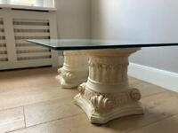 Glass table with plinths