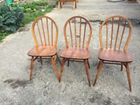 THREE ERCOL DINING CHAIRS, ONE HAS HAD A LEG REPAIR, GOOD CONDITION, DELIVERY AVAILABLE