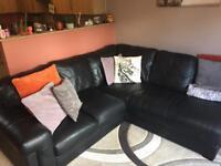 Black leather Italian corner sofa