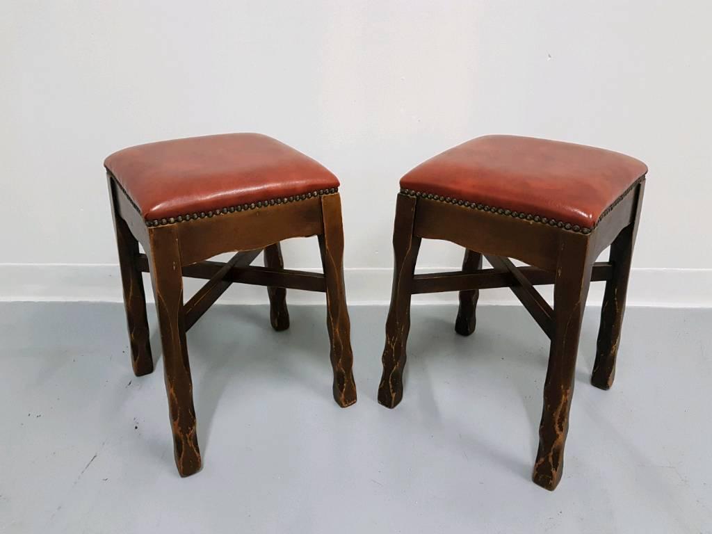 Vintage original unique bar stools with studded red vinyl tops twist legs