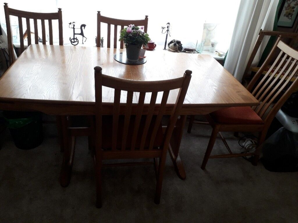 Ercol Golden Oak Extending Dining Table And Four Chairs
