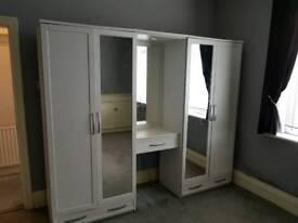 Large double grey wardrobe
