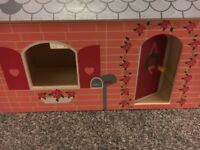 Portable wooden dolls house