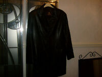 A MANS KNEE LENGTH BLACK LEATHER COAT
