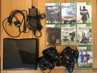 Xbox 360 (250GB), 4 controllers plus dual charging system, plus 7 games